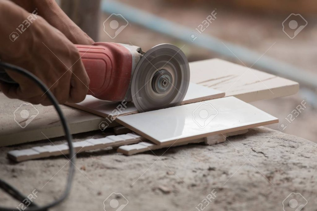 angle grinder cutting a tile