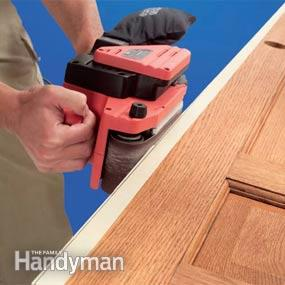 how to use a belt sander on a door